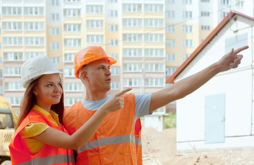 Portrait of builders at building site