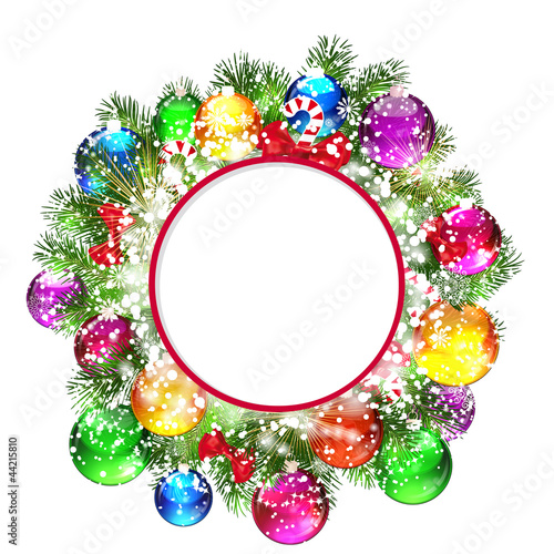 Christmas wreath with snow-covered branches of Christmas tree.
