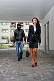 Bandit in mask following businesswoman. Robbery concept