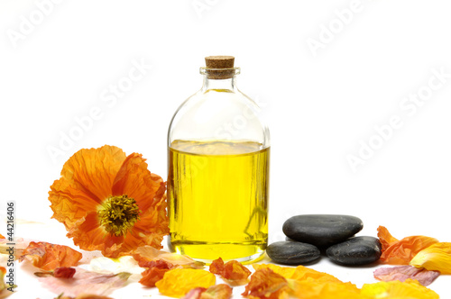 bottle of essential oil with colorful flower plants