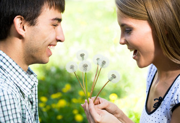 Couple with dandelions