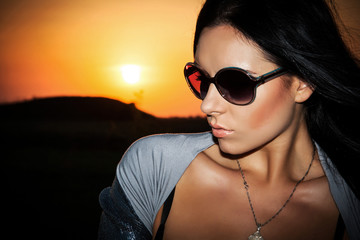 girl wearing spectacles at sunset