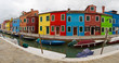 Burano panorama with canal and colourful houses.