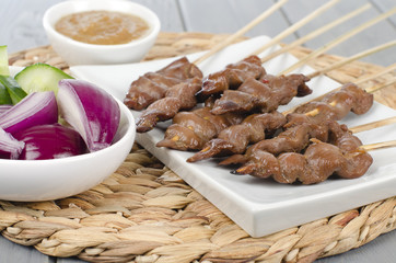 Duck Satay served with peanut sauce, red onions and cucumber.