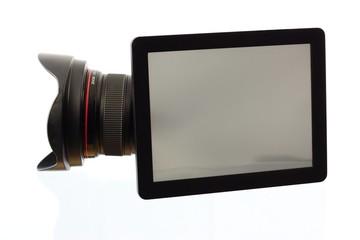 Fotolinse hinter einem Tablet-PC
