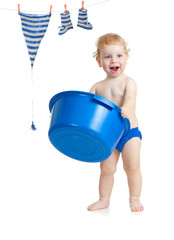 Happy kid washing his accessories