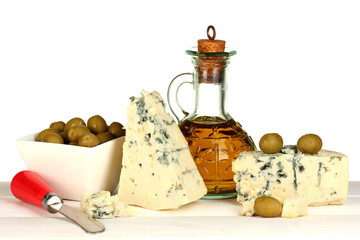 composition of blue cheese and olives in a bowl