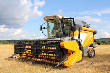 Modern Combine Harvester on Field