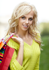 Beautiful blonde shopping woman  outdoor