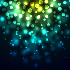 Abstract bokeh yellow and blue lights background.