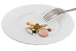 Pills on a plate with a fork