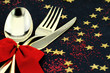 Spoon, fork and knife stacked up on a starry background
