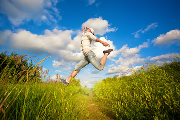 woman jumping over the blue sky