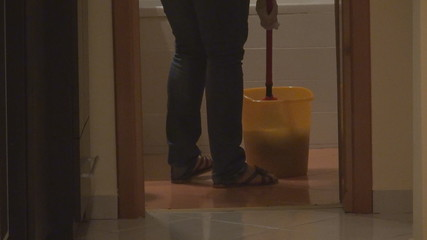 Woman cleaning his house