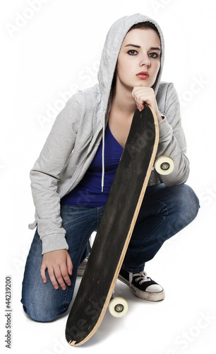 teenager girl with skateboard white background