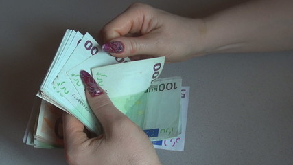A business woman counting Euro for a transaction
