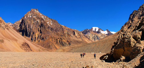 Mountain panorama with hikers trekking in Andes, South America