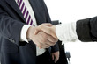 handshake of business man and woman in suits