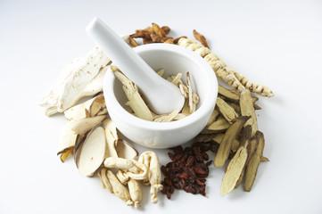 medicinal herbs and small mortar