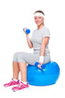 attractive sportswoman doing exercise for biceps