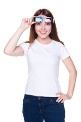 girl in white t-shirt holding 3d glasses
