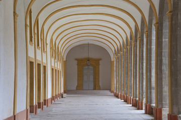 corridor of a cloister in cluny abbey