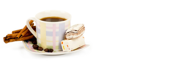 Coffee cup with sweets an cinnamon on white background