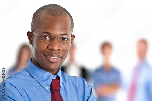 Businessman in front of his team