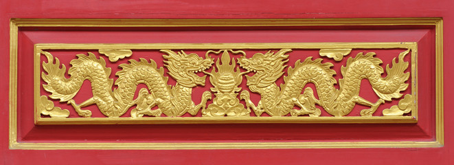 golden dragon decorated on red wood wall