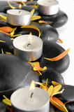 Set of candle and flower petals with pebbles