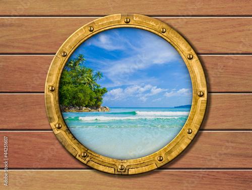Fototapeta ship porthole with tropical island behind