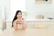 Beautiful young woman relaxing in kitchen