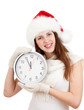 Cute girl in Christmas red santa hat with clock over a white bac