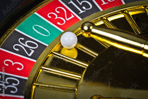 A roulette with the ball in 0