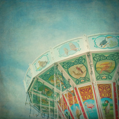 Closeup of a colorful carousel with textured editing