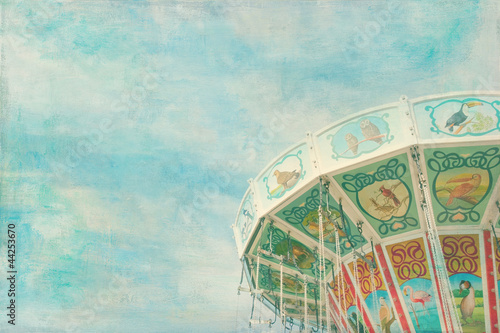Closeup of a colorful carousel with painterly textured editing