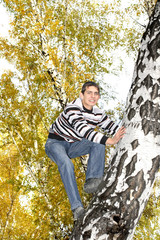 teenager climb a tree