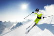 Skier in mountains, prepared piste and sunny day - 44261019