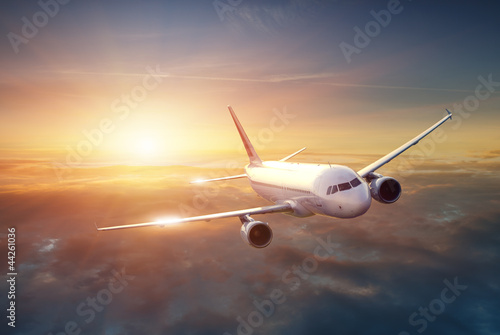 canvas print picture Airplane in the sky at sunset