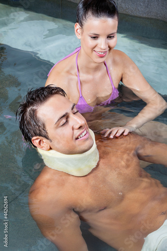 Man In Pool with Beautiful Woman