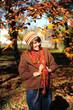 Girl in autumn park.