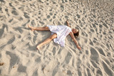 baby-girl sleep on the sand