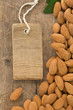 nuts almond and tag price on wood