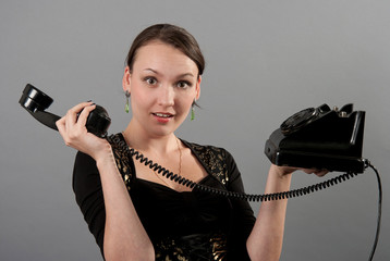 Girl with a vintage phone