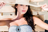 Beautiful girl with hat at the beach