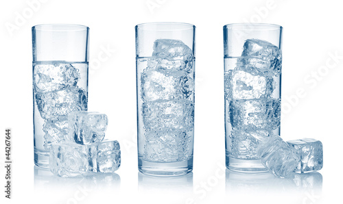 Set of glasses with fresh cool carbonated water and ice