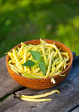 yellow kidney beans in a bowl on wooden table