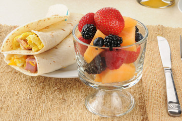 Cup of fruit and breakfast burritos