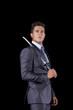 Businessman holding a ninja sword