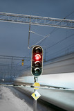 Train and red signal at railway crossing